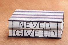 "handmade Twin-book with the words ""Never Give Up"" 