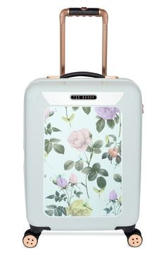 Travel in style with this adorable hard shell suitcase from Ted Baker! The rose pattern makes it especially eye-catching.