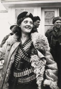 A propaganda photo of a Soviet female partisan, 1942.