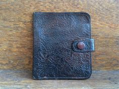 Vintage English tudor calf leather brown folding wallet circa 1960's Purchase in store here http://www.europeanvintageemporium.com/product/vintage-english-tudor-calf-leather-brown-folding-wallet-circa-1960s/