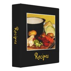 This recipe binder is decorated with the makings of a fine vegetable soup. The carrots, beets, cabbages, potatoes, onions, garlic and celery are chopped and ready for the pot. The black background and gold text complete a cheerful, homey kitchen design. The text is customizable to meet your needs.  From Bebops on Zazzle!