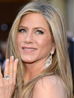 Best: #JenniferAniston. Happiness looks good on her! The engaged actress flashes her pearly whites and massive rock. #Oscar2013