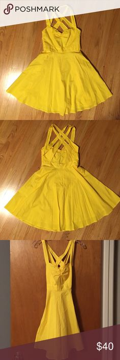 Flirty yellow halter strappy sun dress Fun and flirty canary yellow dress  Sweetheart neckline with halter straps Crisscross back straps Fitted bust with flared skirt Fully lined, cotton  Size 2  Worn only once EUC Moda International Dresses Mini