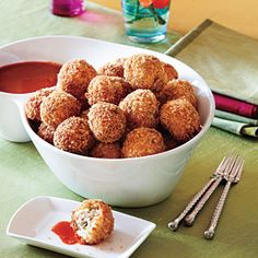 Bacon-Grits Fritters     A Southern cooking perfection, these tasty treats take the best of breakfast—grits, bacon, and sharp cheddar cheese—and re-create them as scrumptious fried balls. Serve with hot sauce.