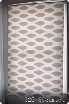The roller shade is just a simple one found at Home Depot for $3.85~look in their miscuts and you can usually find one that will work. Then  just cover it with fabric (Premier Prints chipper twill storm) from Fabric.com  $7.48/yard 1.5 yards = $11.50