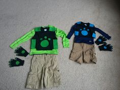 Wild Kratt brother costumes....using dollar store black t-shirts and a sheet of blue and green felt. A little cutting and fabric glue to adhere and done!