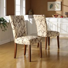 @Overstock - Give your space a fun update with these upholstered accent chairs. This set includes two chairs with rubberwood frames and linen upholstery. The brown swirls on a tan background make a bold statement; it's an ideal addition to any decor.http://www.overstock.com/Home-Garden/Chocolate-Swirl-Print-Accent-Chairs-Set-of-2/4401057/product.html?CID=214117 $119.99