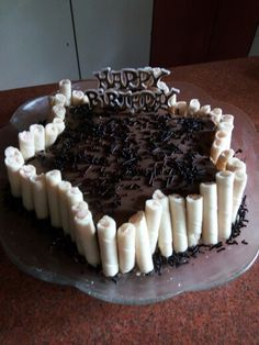 Chocolate cake with chocolate  glaze icing  yummy decorated with wafer sticks super cake for any age group