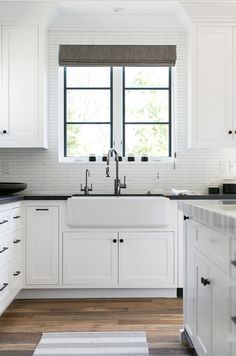 farmhouse kitchen 669629038325080633 - Modern Farmhouse White Kitchen with Black Countertops and Black Window Trim Source by pickledbarrel Backsplash Kitchen White Cabinets, Farmhouse Sink Kitchen, Modern Farmhouse Kitchens, Kitchen Cabinet Design, Black Kitchens, Interior Design Kitchen, Cool Kitchens, Backsplash Ideas, White Farmhouse