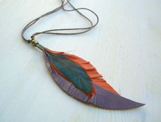 Feather and Leather Necklace  orange and purple by elebyhelenmark, €20.00
