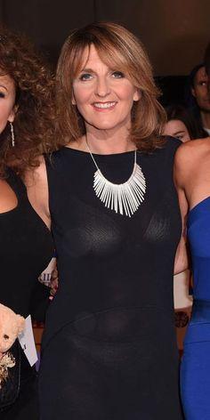 Kaye Adams lets her undies shine through a sheer black dress.