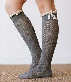 Gray lace socks have a chevron pattern running through them with crochet lace trim on top and two buttons. Great with shoes or peeking out the top of boots. Scrunch them down with ankle boots or to gi