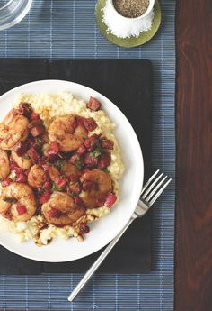 This hot and spicy shrimp recipe takes its cue from Cajun seasoning, red pepper sauce, and red pepper flakes. Serve with andouille sausage and grits to complete the meal. #shrimp #seafood