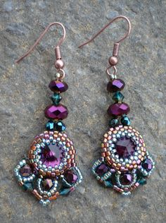 Earrings; peyote stitched cabouchons and chrystal embellishments. Beautiful done!