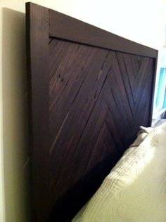 King headboard made from oak pallets, my husband and I's labor of love!