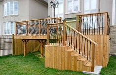 Cedar Deck with wrought iron railings stairs and under deck storage, by Toronto Decks And Fence Company http://www.decksandfence.ca/