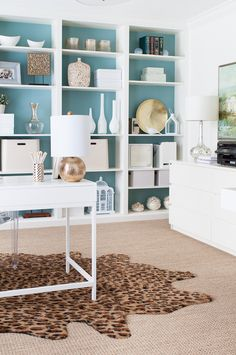 A bright office with some DIY built-ins offer plenty of space for storage. Accessories and matching lamps from Homegoods bring the look together. (sponsored pin)