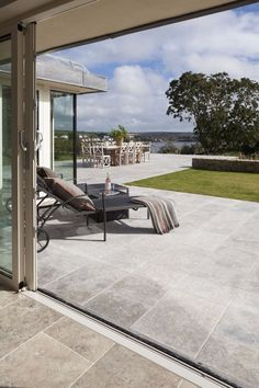 Link your interior to your exterior with our outdoor stone flooring range at Mandarin Stone. Browse options and buy outdoor stone tiles online. Limestone Patio, Limestone Flooring, Outdoor Paving, Outdoor Stone, Pool Paving, Outside Flooring, Outdoor Flooring, Modern Flooring, Patio Tiles