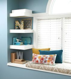 Small stretches of wall space next to windows and doors are all too often ignored when it comes to master bedroom storage. Here, a trio of clever shelves with heft offers space for artful display of treasured mementos./