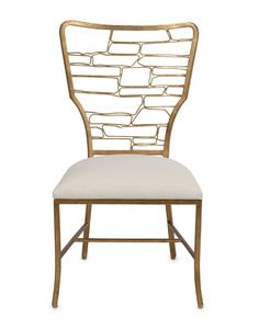 FREE SHIPPING IN THE US. USE CODE LOVE10OFF FOR 10% YOUR ENTIRE PURCHASE. NEW 2016.The open geometric framework back, with its irregularities and jagged edges, suggest handcrafted iron work rather than another mass production. The Vinton, finished in Contemporary Gold Leaf, is a comfortable well-sized chair, without being too wide so to allow for more seats at the table. For Custom upholstery options and price please email us at hi@lovecup.com.