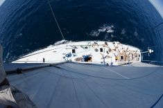 View of Sailboat During Race From Mast stock photo