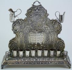 Antique sterling silver menorah -- this is similar to the brass menorah we had growing up.