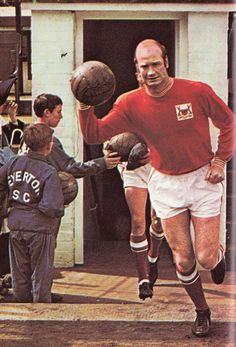 31st August 1968. Nottingham Forest and Wales utility player Terry Hennessey leading his side out at Goodison Park.