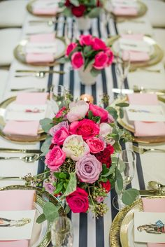 The black and white striped runner adds a whimsical touch to this Valentine's Day table, but it's the multi-colored roses that really steal the show.