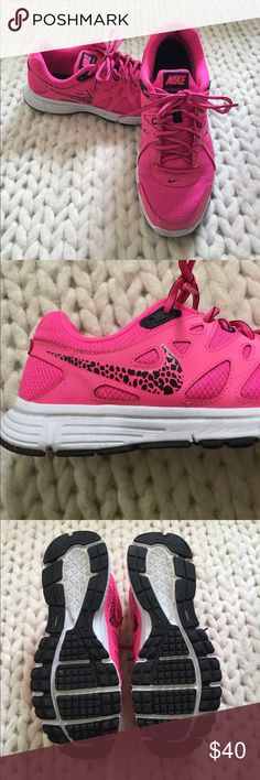 Nike Revolution 2 gym shoes Hot pink with black accents nicks revolution 2 gym shoes. Super cute pink and black leopard swoosh symbol.  Only worn a couple of times. Nike Shoes Sneakers
