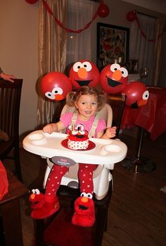 Make your own elmo balloons.  I say forget the balloons!  Look at those cute slippers!