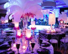 Great Gatsby - Art Deco - Roaring 20's - Old Hollywood - Speakeasy Themed Stage and Event Decor. Featuring Light Up Stage Steps, Columns, Lit Palm Trees, Beaded Curtains, Uplights, White Drape and  a Gobo on the Dance Floor.   http://www.shagcarpetprops.com/category-s/85.htm http://www.shagcarpetprops.com/category-s/101.htm