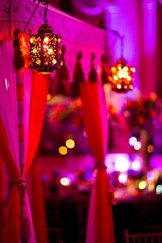 Dim lanterns and bright drapes! -- Indian wedding decor idea by charlene. I could do this- www.atlantaweddingdecor.com