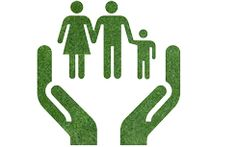 Caring for the environment, arms out of the grass with family