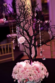 Love this concept for a Wedding Center Piece bling and flowers!