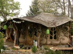 This beautiful cob and straw bale home sits on the banks of a small stream in Somerset, England. It's the work of Lisa and Rich who built the house with clay from the stream and roundwood Pine and Hawthorne thinned from the local woodlands. The roof is tiled with cedar shingles and the walls are straw bale on the north and east with sculpted swirls of cob on the south and west.