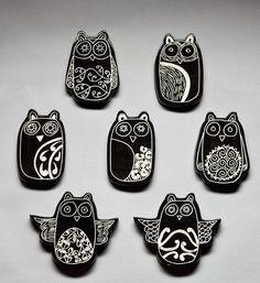 """Borrowed earth ceramic owls, """"ruru""""."""