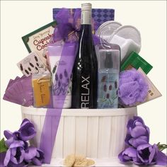 Surprise your mom with this gorgeous wine and spa gift basket featuring a bottle of RELAX Mosel Riesling white wine to delight the senses with aromas of fruit and floral notes. It also includes a generous selection of gourmet chocolates and snacks as well as a luxurious array of spa products. Featuring San Francisco Soap Company Lavender scented bath products, Cotton Terry Bath Slippers, 7 Piece Manicure Set in a Travel Case, and delicious sweets including DeGeneve Dark Chocolate Mint…