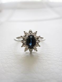 """Beautiful vintage estate solid 10k white gold antique style ring featuring a vibrant blue center oval cut sapphire and baguette and round diamonds in a halo ballerina princess style ring setting. Classic versatile design - art deco / Edwardian / Georgian / Victorian / Great Gatsby overall classic style.  A great birthstone ring gift, promise ring, or a stunning engagement or wedding ring - """"something old"""" and """"something blue"""" bridal jewelry for the bride."""