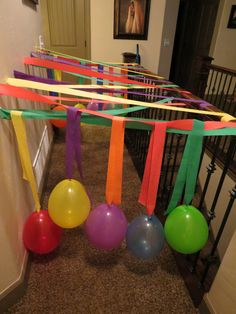 Birthday morning surprise- kid gets to charge through the crepe paper and balloons- great way to start their special day :)