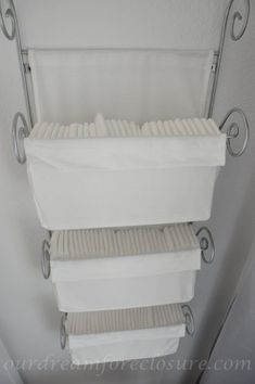 Ikea magazine rack turned diaper storage. I NEED this! (this would have been nice when I was cloth diapering :/)
