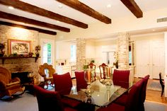 like fire place with rockers and beams on ceiling.