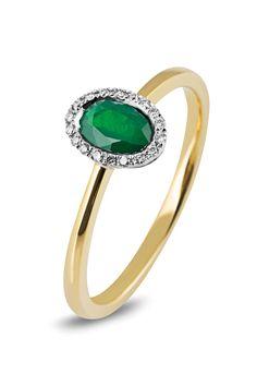 Bicolor ring van Siebel Signature. De ring is gezet met een ovale smaragd en daaromheen 18 diamanten van totaal 0,05 crt.