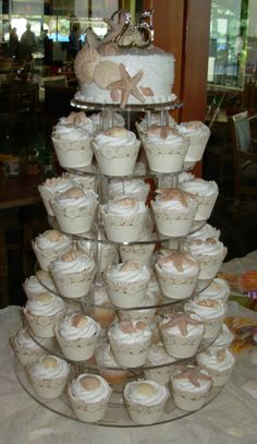 Lots of cute cupcake tower ideas and decorating inspiration Beach Wedding Cupcakes, Beach Cupcakes, Beach Wedding Reception, Fun Cupcakes, Cupcake Cakes, Our Wedding, Wedding Cakes, Beach Weddings, Wedding Ideas