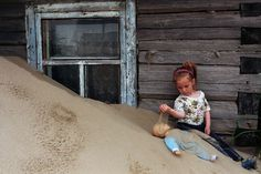 Russian Village being swallowed by sand