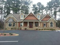 What I want my future house's exterior to look like love the wood accent with the stone!