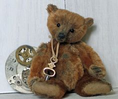 "Paula Strethill-Smith miniature artist teddy bear. Tick Tock is created from genuine antique mohair and is 3.5"" high. He has a centre seam head with a wobble neck joint and wears a vintage watch key around his neck."