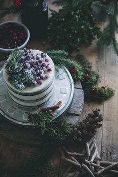 Soft gingerbread cake with cream cheese frosting and sugared cranberries