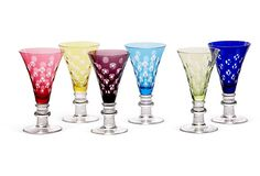 Dramatically colored cased crystal water goblets are cut with circles. This set will make a bold statement.