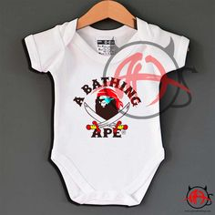 A Bathing Ape Pirates Baby Onesie Pirate Baby, Toddler Humor, A Bathing Ape, Baby Onesie, Custom Shirts, Baby Gifts, Kids Fashion, Hypebeast, Pirates