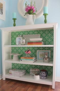 Wallpaper the inside of book case. Love this extra touch in a standard bookcase. Great DIY home decor idea.